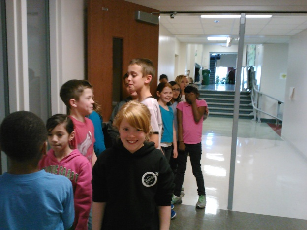 Anticipating our fabulous feast as we wait outside the cafeteria!