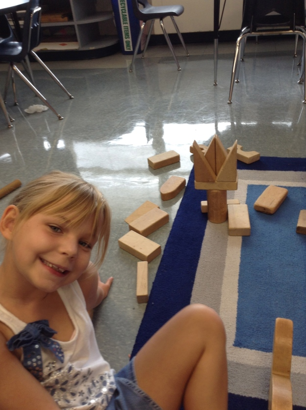 "One of my favorite things is to see how kiddos' brains work while they are building.  For some reason when I look at blocks (including Legos), I see ""square"" things like houses, cars and buildings.  I love how others see more organic things in those blocks.  Kylie made a flower here. :)"
