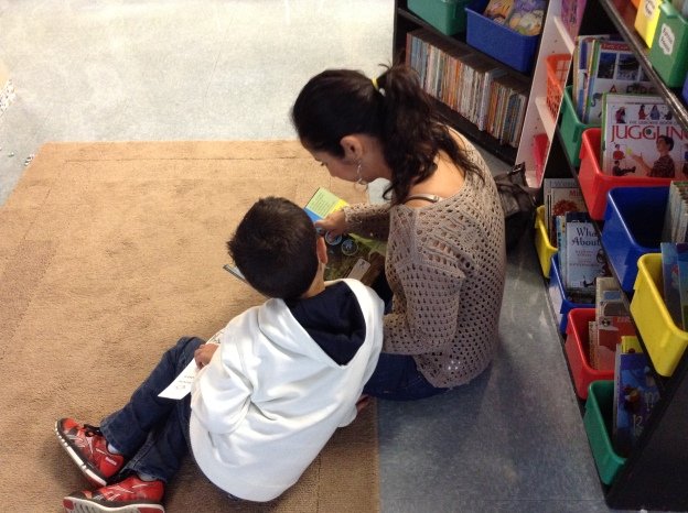 Diego and his mom enjoy a story together!