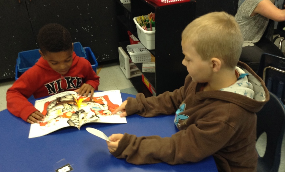 Even little Roadrunners can read together--C.J. and Landen are checking out a new book fair book--Bugs in My Hair!