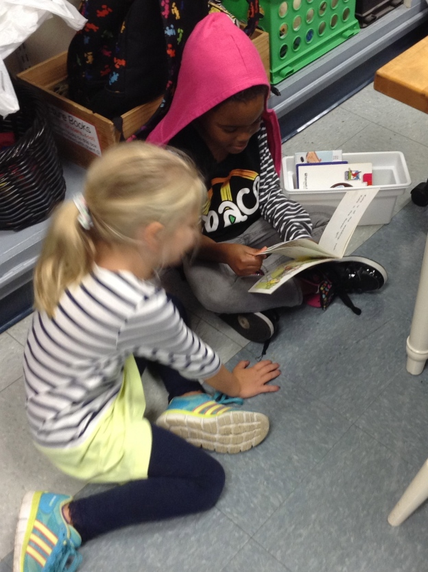 Briannia and Amelia are checking out her bookbox together.