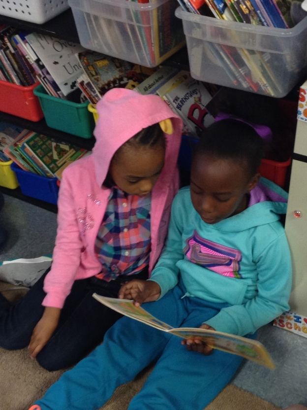 Two more super-focused Roadrunners--Sara and Makayla--read together.