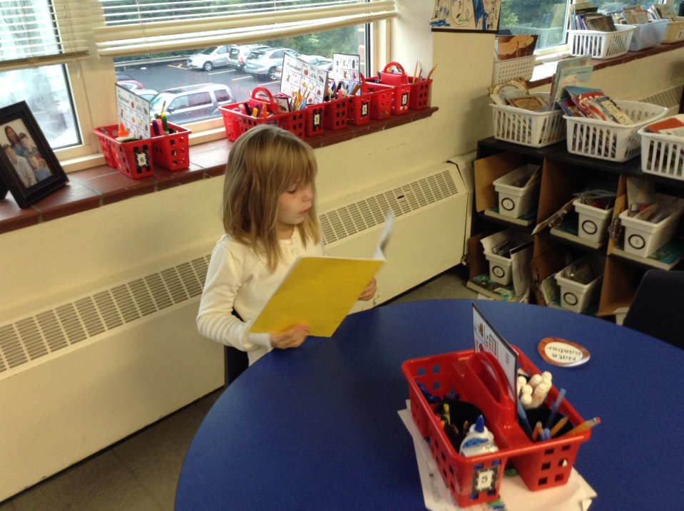 Some friends chose to read alone: Kylie is busy with a favorite story.