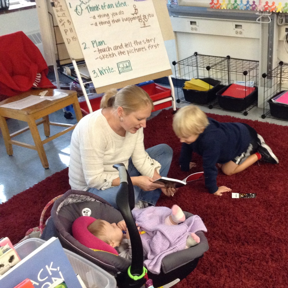 Evan, his mom and his baby sister are enjoying a new Captain Underpants book--another good find from our book fair!