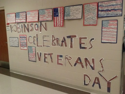 This nonfiction writing helped us celebrate Veteran's Day and was found outside the gym.
