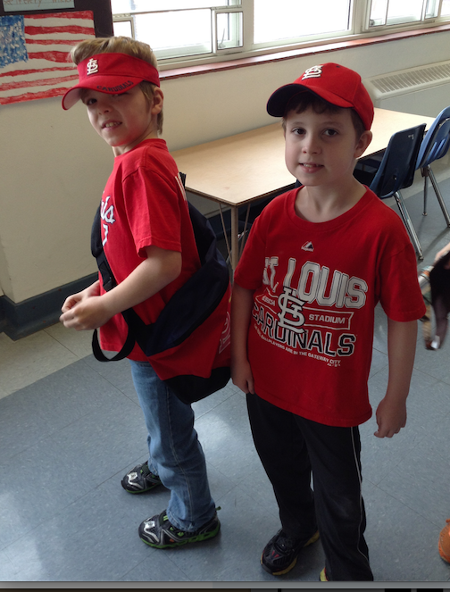 Those are some pretty awesome Cardinals' fans, aren't they?  Look, C.J.'s backpack even has Cardinal red on it!  Looking good, kiddos!