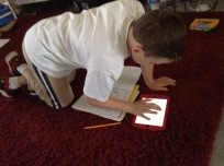 Thomas was using Notability on his iPad to record his thoughts, then replay them so he could write the sentence word-by-word. LOVE how technology supports our work. :)