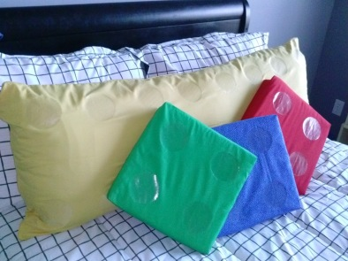 The yellow is a body pillow, and the others are just square foam inserts.